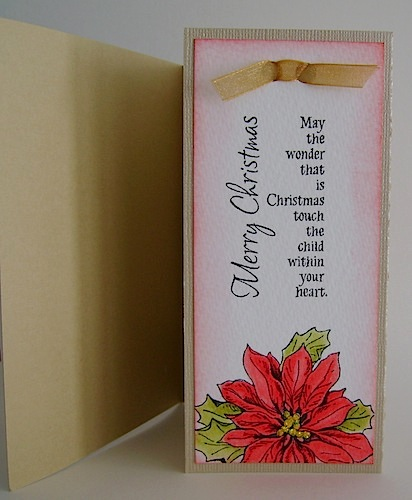 inside of christmas card with poinsettia and detachable bookmark
