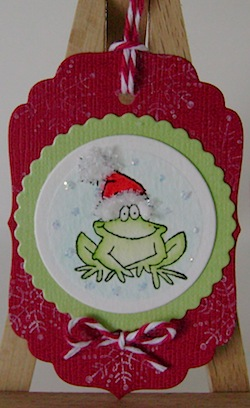christmas tag featuring frog with red and green trim