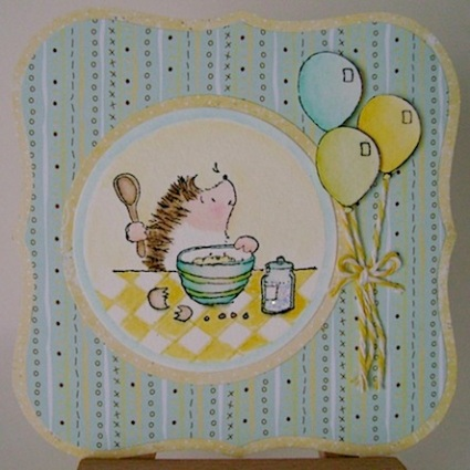 birthday card featuring hedgie and three balloons in blue, green and yellow