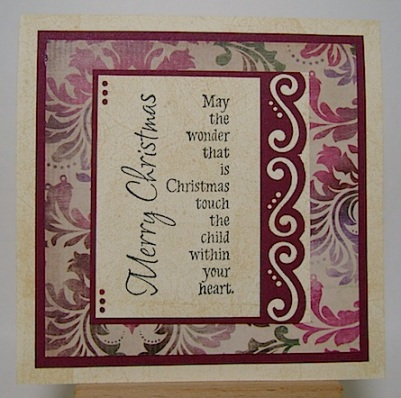 christmas card in maroon, green and ivory with sentiment as focus on front