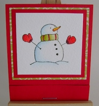 matchbook candy holder front featuring snowman in red and green