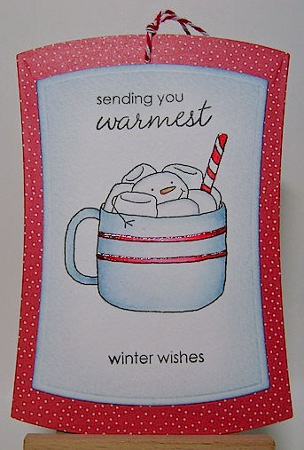 tag featuring marshmallow snowmen in blue mug with red stripes and peppermint stick