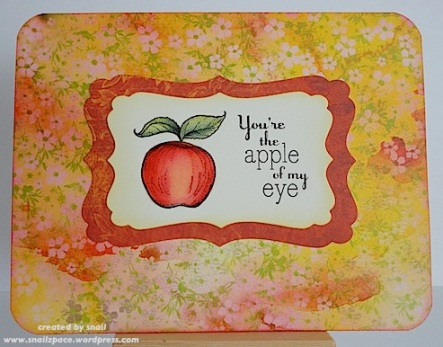 card featuring apple with apple of my eye sentiment on a bright yellow and red background paper