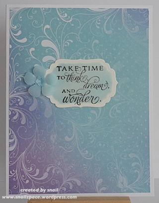 card with blue and purple paper with white flourishes on it, sentiment and blue flower