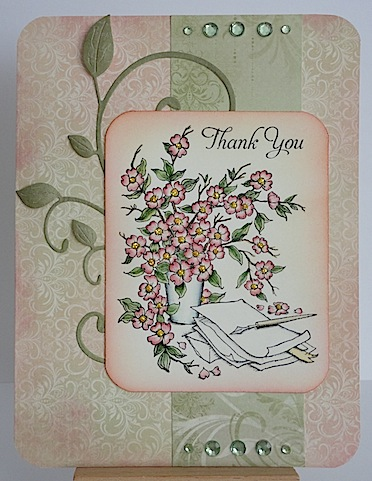 card with pink and green and a vase of flowers with thank you sentiment