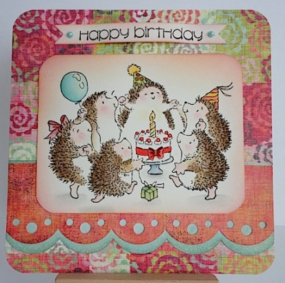 card featuring hedgies in a circle with cake and party hats and balloon