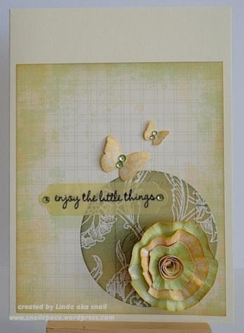 ivory card with green and yellow flower and butterflies