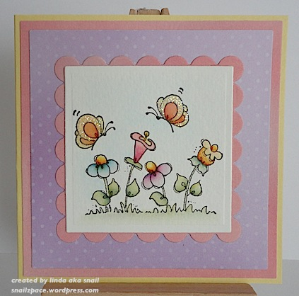 card with pink blue and yellow flowers and yellow orange butterflies penny black image