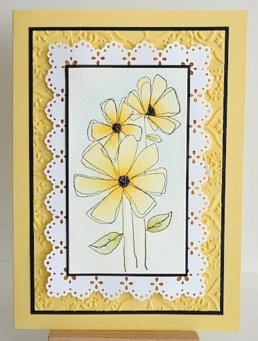 card featuring penny black gossamer flowers in yellow with black and white trim