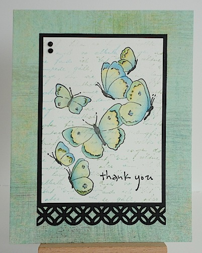 card featuring blue and green butterflies on front of blue/green card