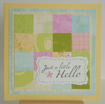 card with patchwork pastel colours and just a little hello magenta stamp sentiment
