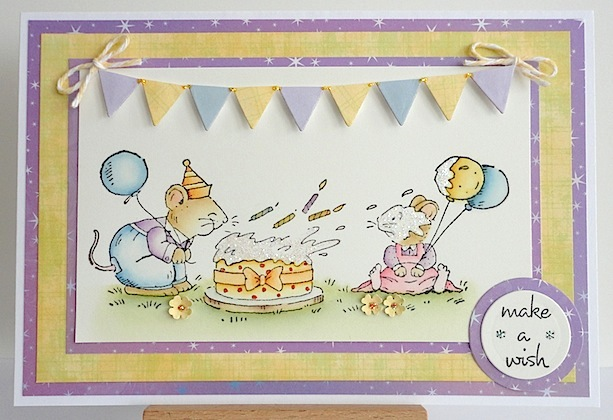 birthday card with two mice, one blowing candles out and another with balloons in yellow, blue and purple colours