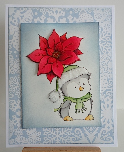 christmas card featuring a penguin holding a red poinsettia