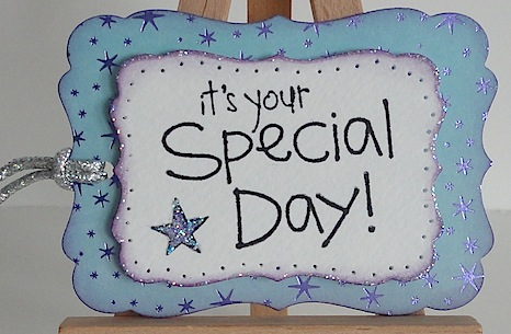 penny black sentiment stamp it's your special day on tag in purple and blue