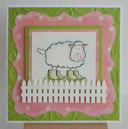 pink and green card featuring penny black sheep image wearing green boots