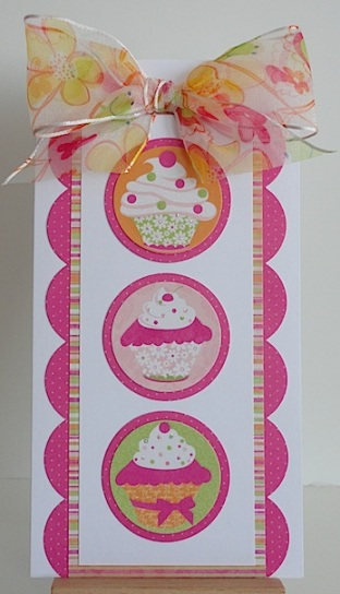 card in pink, yellow and orange with cupcakes and ribbon