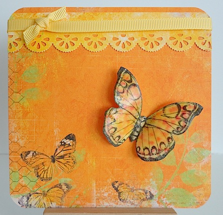 card in orange with yellow ribbon and butterflies
