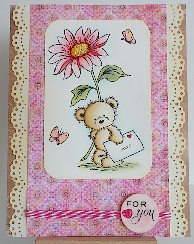 lili of the valley teddy with pink flower