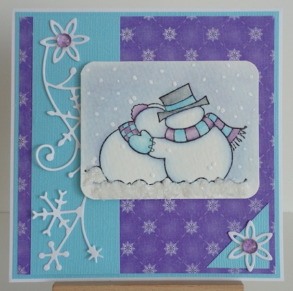 card featuring penny black snowy couple in purples and blues