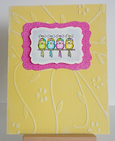 four birds on a wire in pink, blue, yellow, green on a yellow card base
