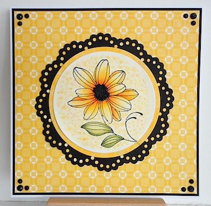 card in yellow and black with penny black flower stamp
