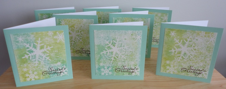 set of 8 christmas cards in blue and green with white snowflakes and season's greetings sentiment