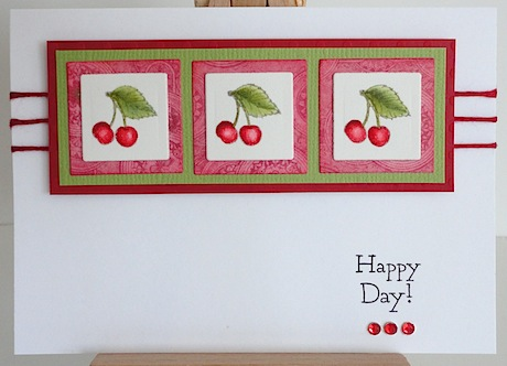 card with cherries and happy day sentiment flourishes