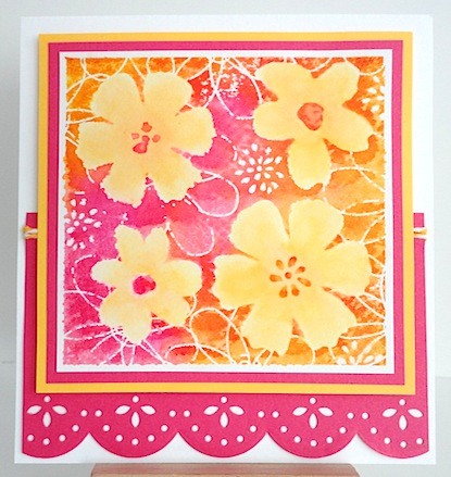 card with four yellow flowers on pink, tangerine and white base