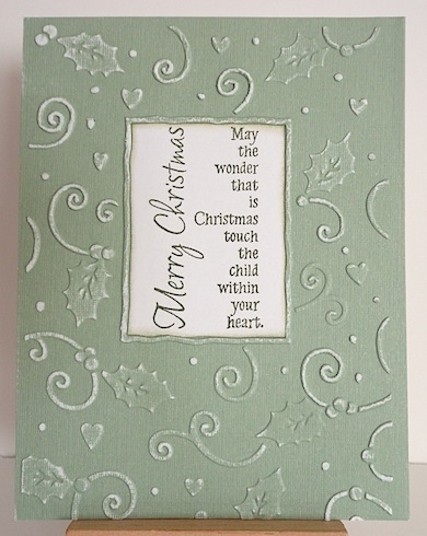 christmas card in green and white in embossed swirl and holly pattern