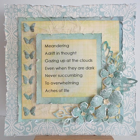 acrostic on blue and ivory card with die cut flowers and butterflies