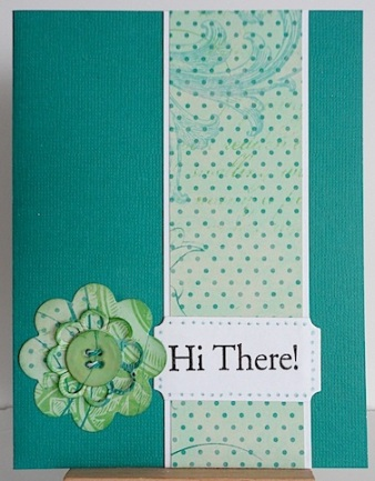 teal card with hi there sentiment and layered diec cut flower