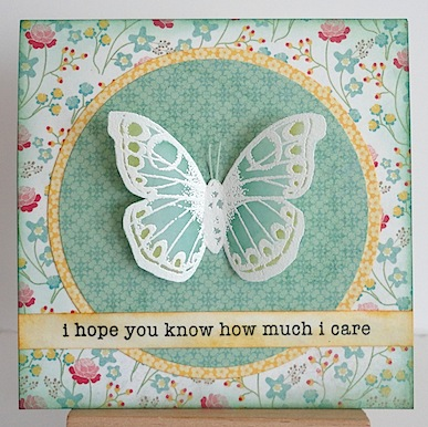 card with vellum butterfly in teal on a teal patterned paper circle