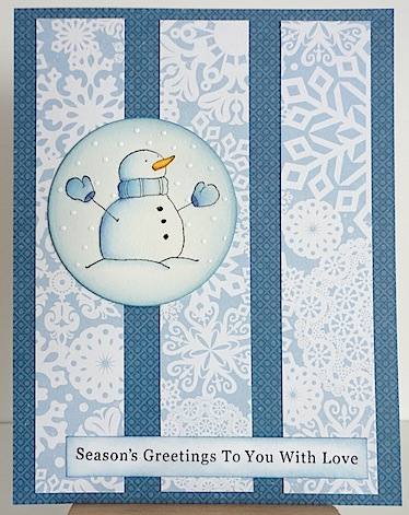 blue and white christmas card with snowman