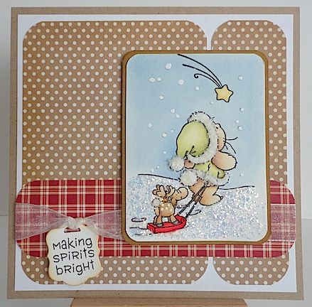 card with bunny pulling sled holding reindeer on brown with white polka dot paper and red check paper trim; also a making spirits bright sentiment
