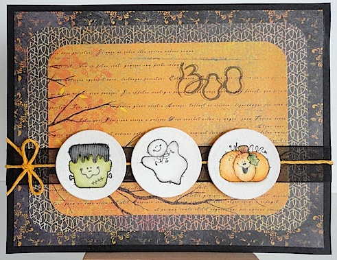 halloween card with three penny black stamps and a boo sentiment on orange and black papers