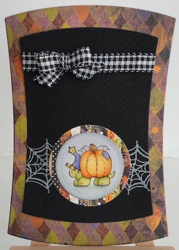 halloween card with turtle carrying a pumpkin