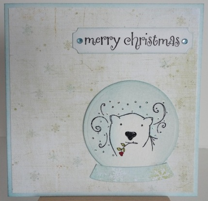 polar bear in snow globe with merry christmas sentiment