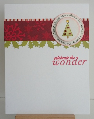 clean and simple christmas card in reds and greens with tree, merry christmas circle sentiment and celebrate the wonder sentiment