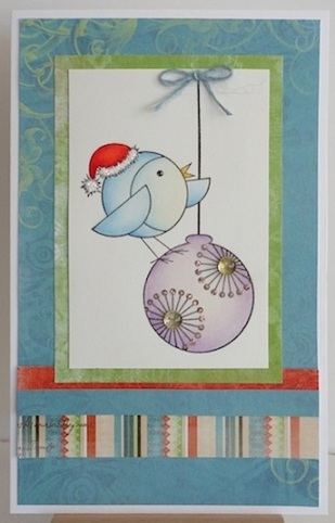 christmas card with blue bird on a purple ornament