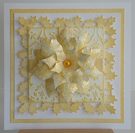christmas card in gold and white with gold glittered poinsettia