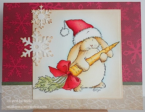 christmas card with bunny and carrot in red, green and beige