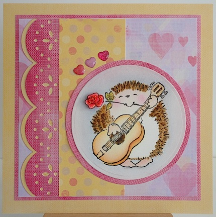 card with hedgie playing guitar in pinks and yellow