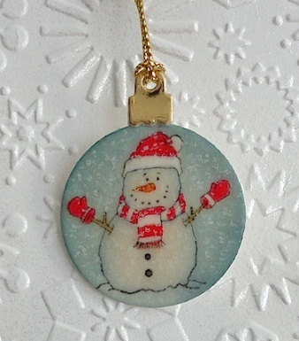 miniature tree ornament with snowman