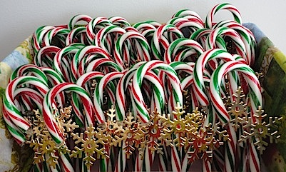 box of red and green candy canes with gold snowflakes
