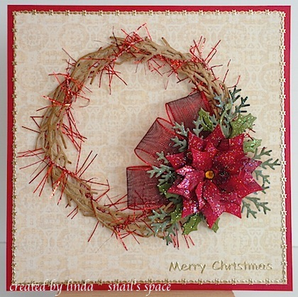 christmas card with grapevine wreath, poinsettia, greenery and red ribbon loops