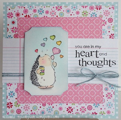 valentine card with penny black hedgie blowing heart bubbles with pinks and blues papers
