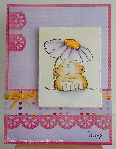 valentine card in pink, purple and yellow with two mice hugging under a daisy