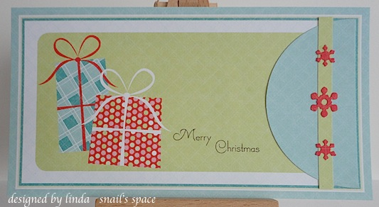 christmas card with two presents in dotted papers of red, white, green and blue