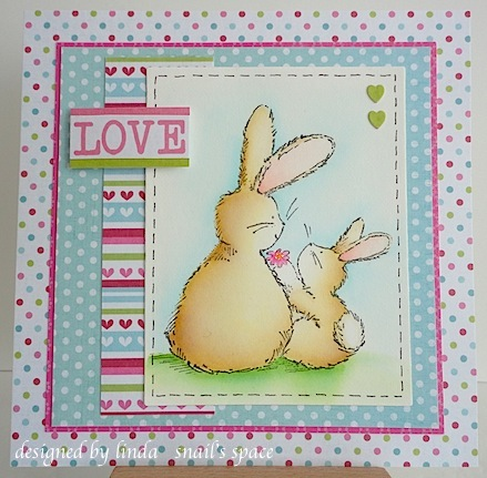 two bunnies with a flower and a love sentiment