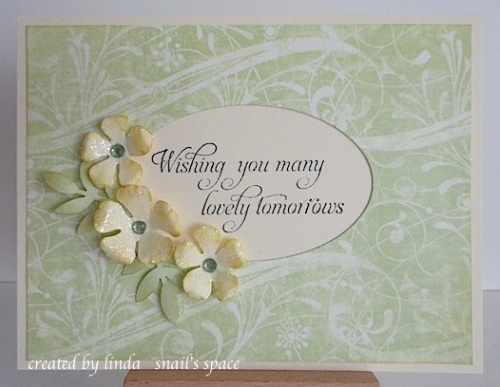 card in green with flowers and wishing you many lovely tomorrows sentiment